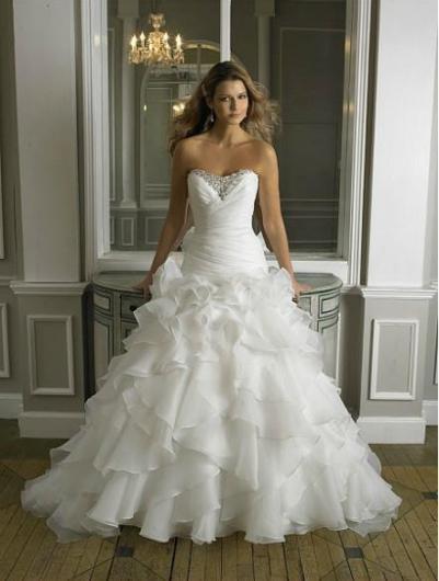 صور صور بدلات اعراس , اجمل الصور لعروس متالقة بفساتين رائعة