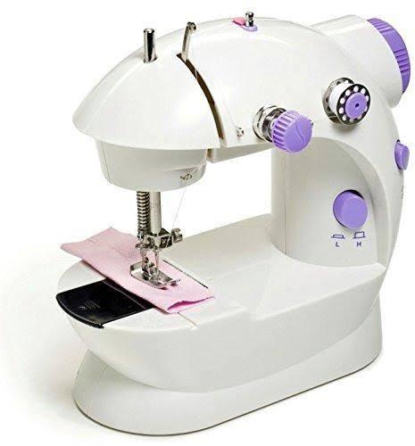 صورة ماكينة الخياطة المحمولة , تجنبي المواقف المحرجه بحمل ماكينه الخياطه